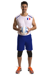 Professional French Volleyball player with ball.