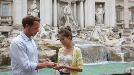 Aufkleber - Travel couple throwing coin at Trevi Fountain, Rome, Italy for good luck. Happy young couple smiling traveling together on romantic travel vacation holiday in Europe. Asian woman, Caucasian man.