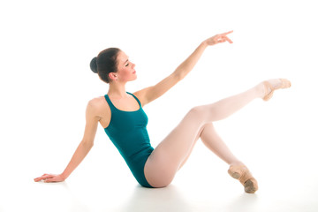 young ballet dancer sitting on floor