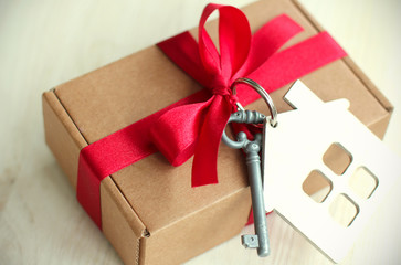 antique gift / a gift with a key and a house in retro colors