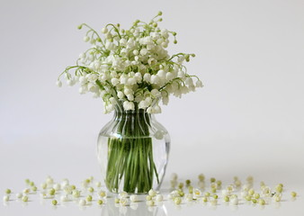 Lily of the valley flowers in a vase. Romantic floral still life with bouquet of spring flowers.