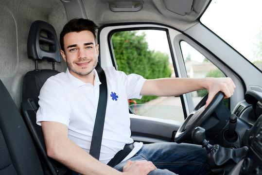 young man driving an ambulance paramedic transportation