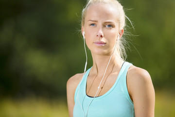 Blonde woman listen to music when she exercise