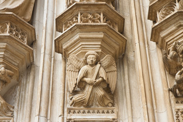Stone angel on the facade of Batalha cathedral in Portugal (Europe)