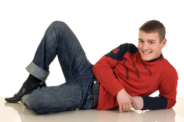 Smiling young man lying on the floor