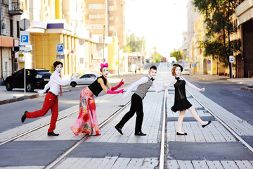 four mime cross the road