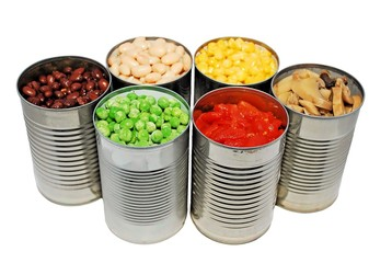 Selective focus of opened cans of vegetables
