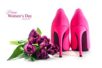 Womens day, pink high heel shoes and tulips isolated on white