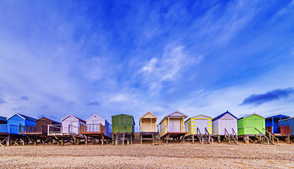 Beach huts with a blue sky background