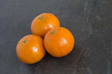 Mandarin Oranges on the slate background