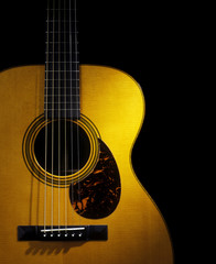Still Life of the Body of an Acoustic Flat Top Guitar on a Black Background
