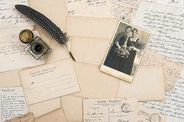 Vintage letters, postcards and antique feather pen