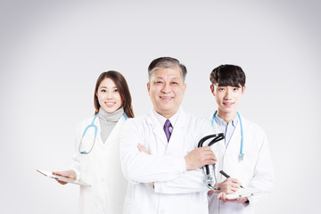 three Asian doctors in hospital