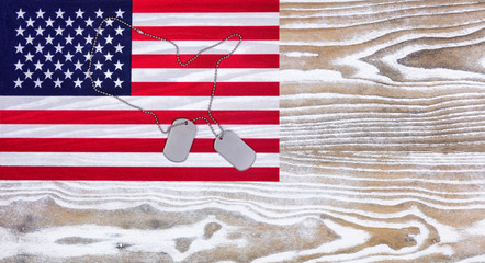 USA Flag and military ID tags on fade white wood background