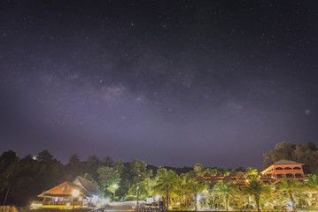 Sky full of stars with milky way.Winter landscape with village i