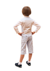 A boy is back in full length, isolated on white background