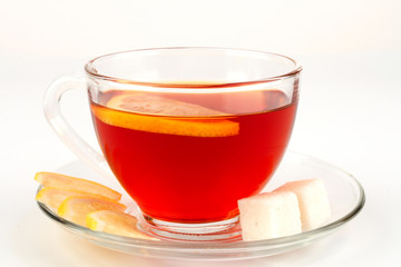 Glass bowl full of tea with pieces of white sugar