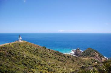 Cape Reinga lighthouse hilly sea coast