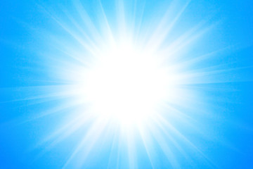 Shining sun at clear blue sky background.