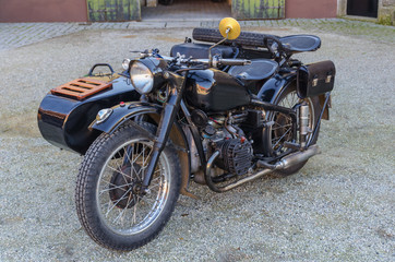 Old motorbike in black with sidecar