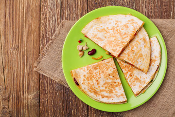 Quesadilla with chicken, served with guacamole or salsa sauce.