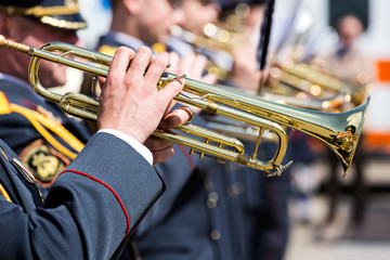 musicians of military orchestra with trumpets at parade