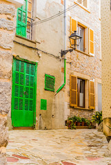 Wall Mural - View of old rustic houses with mediterranean stone wall