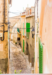Wall Mural - Alleyway of a old rustic village with mediterranean houses