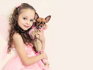 blond kid girl with small pet dog