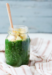 fresh green smoothie with apples, pears, spinach and spirulina