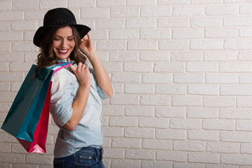 Stylish boho girl with shopping bags
