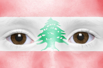 human's face with lebanese flag