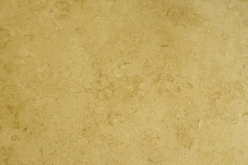 Texture of light brown marble with scratches.