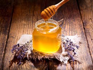pouring lavender's honey into jar