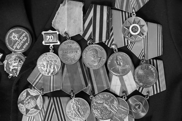Medals veteran of World War 2 on a black background black and white photo