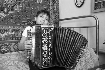 Boy with accordion black and white photo