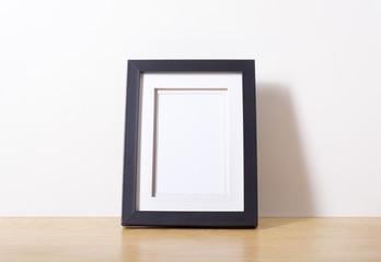 Black picture frame on desk