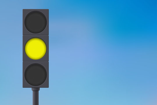 Traffic lights with yellow light on.