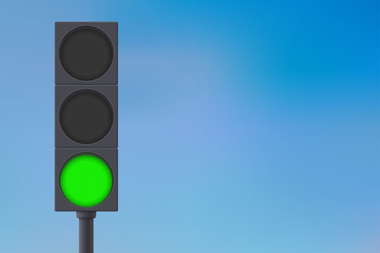 Traffic lights with green light on.