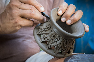 close up potter artist working on clay pottery sculpture fine ar