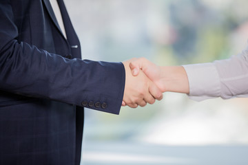 close-up of handshake of two businessmen in business suits