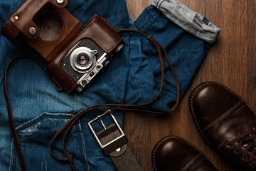 Jeans, boots and photo camera