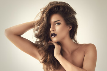 Beautiful woman with dark lipstick