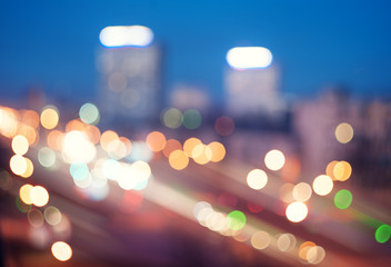 Blurred defocused lights of traffic in the city