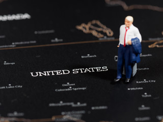 Miniature business man on map of US