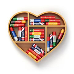 Bookshelf with ictionaries in form of heart. Learning language c