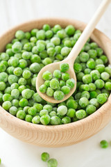 frozem peas on wooden surface