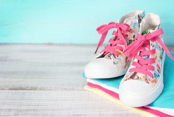 Textile lace sneakers shoes background empty space.