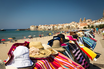 city beach and the street market in Cefalu