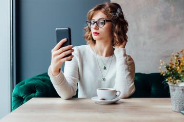 Woman making self portrait